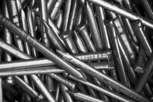 Uncoated iron nails or iron shavings to any other material that will rust are a few options.