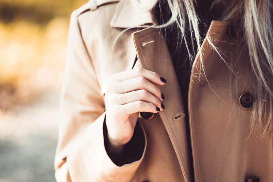 woman wearing a light brown coat