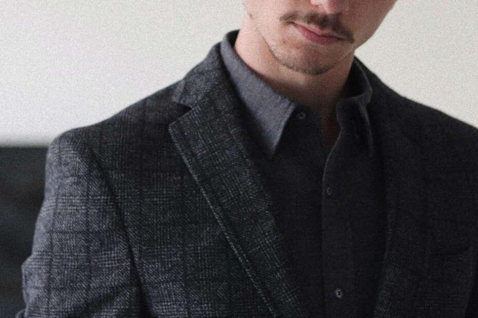 man wearing charcoal grey blazer