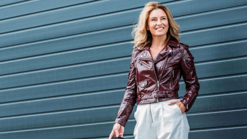 stylish mature woman wearing burgundy leather jacket