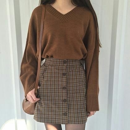 brown chequered skirt with a full sleeved sweatshirt