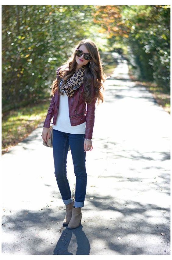 girl wearing burgundy leather jacket with a leopard print scarf