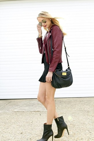 burgundy leather jacket for women with a short black dress
