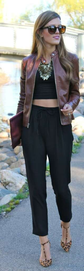 burgundy bomber jacket with black cropped top and high waisted pants