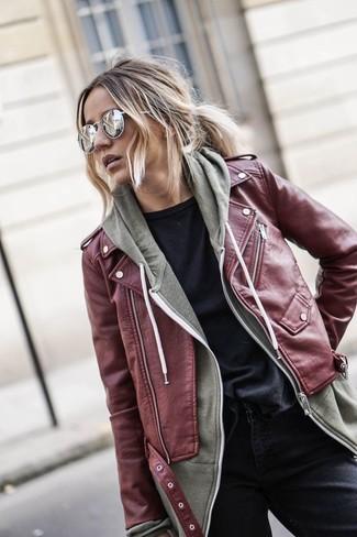 girl wearing a burgundy biker jacket over a hoodie