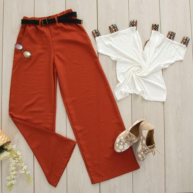 Labor Day street style outfit: Rust wide legged trousers with a stylish white top