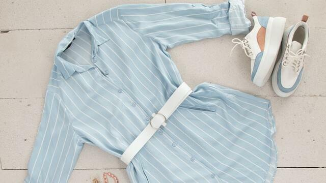 End of summers outfit: a collared shirt dress with a white belt and sneakers
