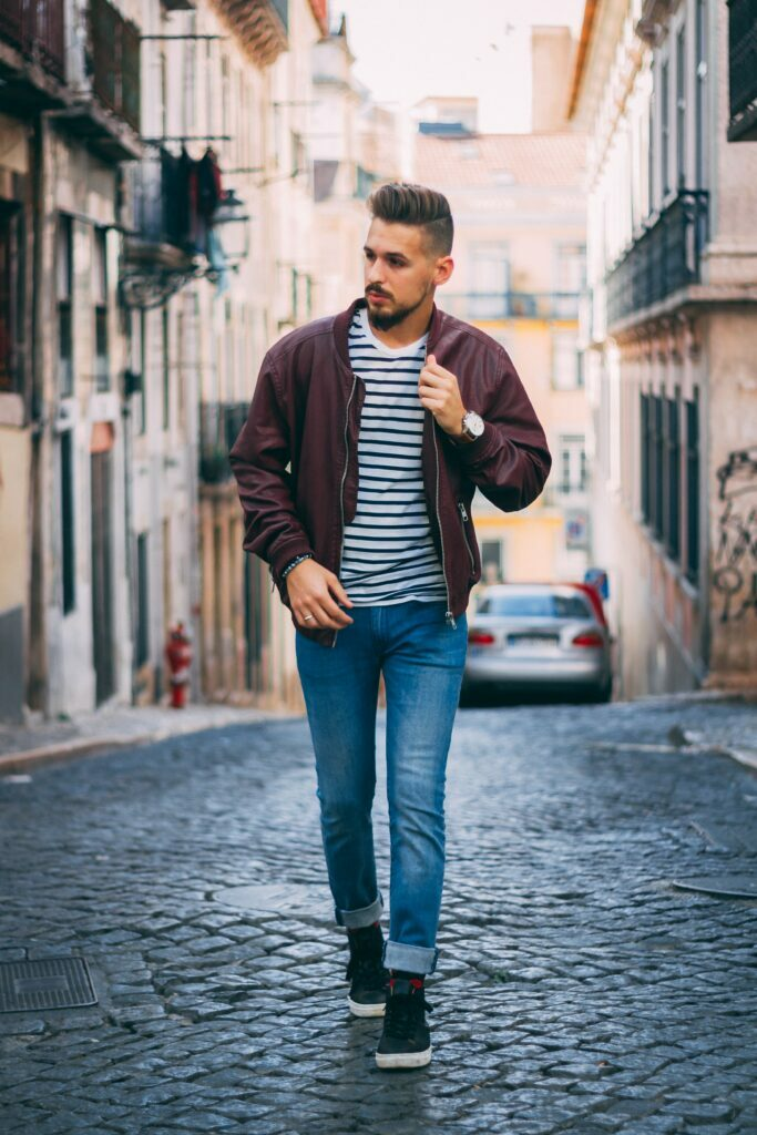 blue jeans and striped t-shirt outfit paired with a bomber jacket