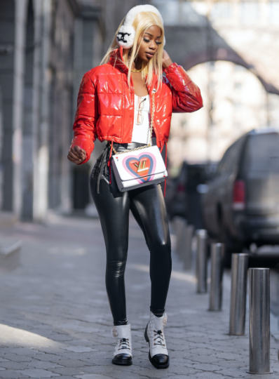 girl wearing a red jacket with faux leather leggings