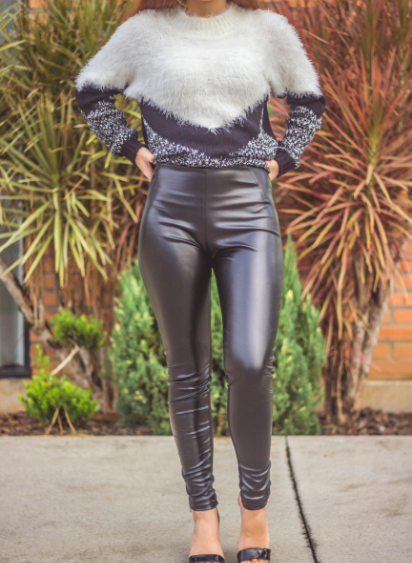 woman wearing a fur top with faux leather pants