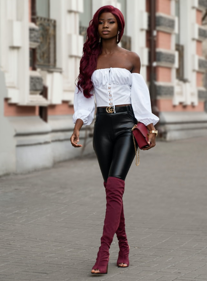 a stylish faux leather leggings outfit with a white off shoulder top