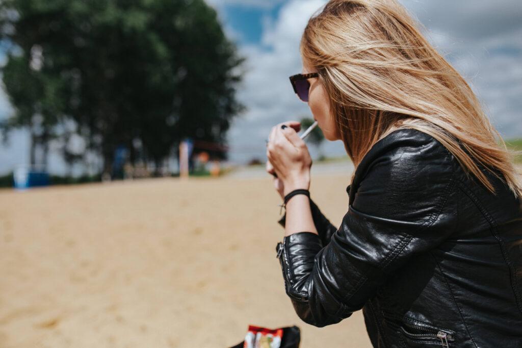 woman wearing a black vintage leather jacket
