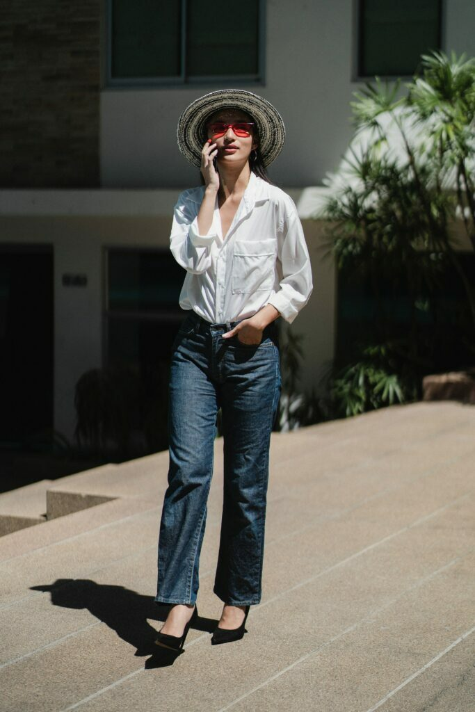 wide legged jeans and white button down outfit for women