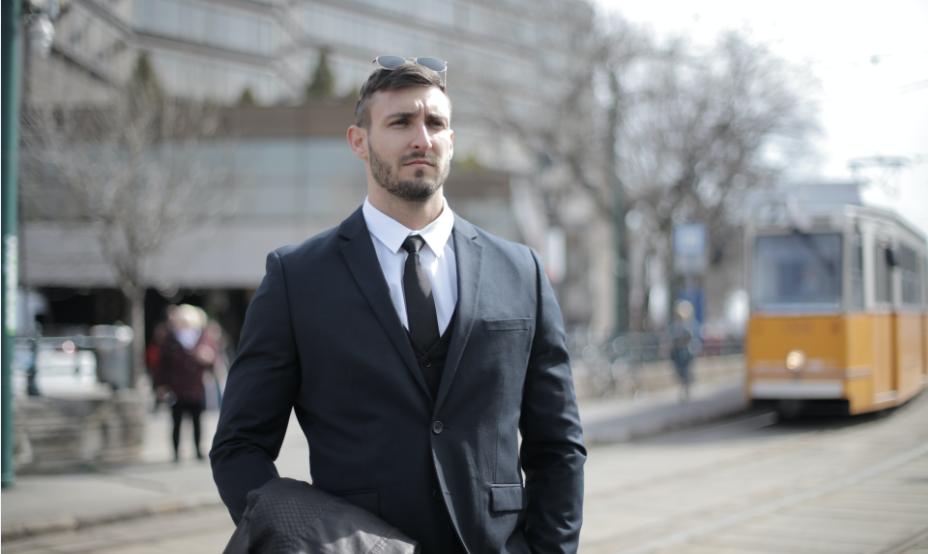 man wearing custom made grey suit
