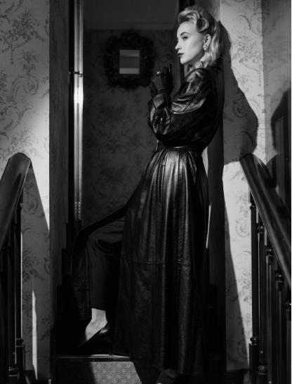 woman wearing black vintage leather coat