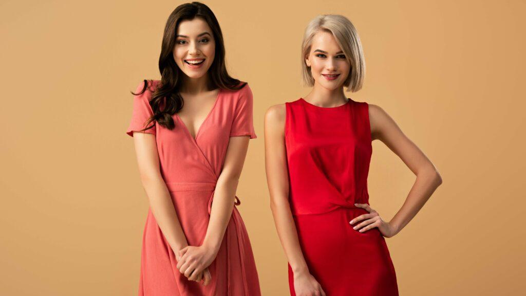 two stylish girls wearing blouson cocktail dresses