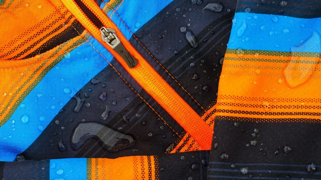 water beading down from a softshell jacket