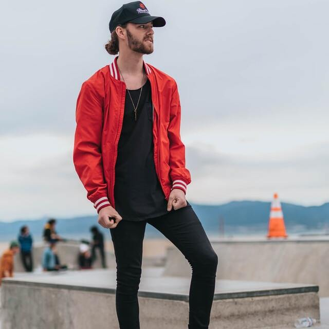 what to wear with black jeans: red jacket outfit