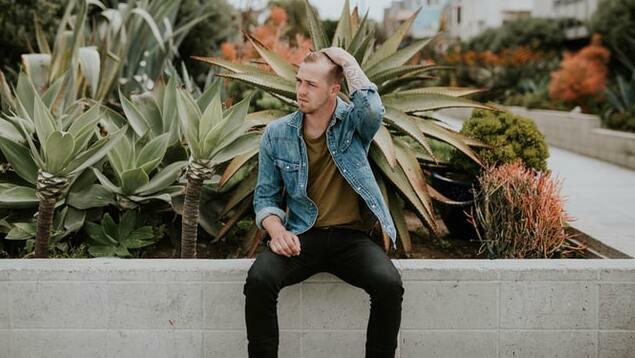man wearing denim jacket with black jeans