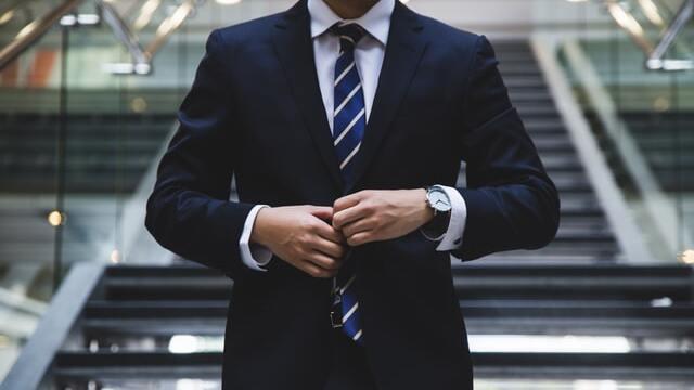 a navy blue semi formal suit for men