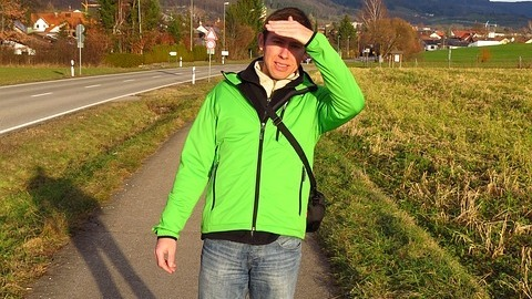 man wearing a flourescent green softshell jacket