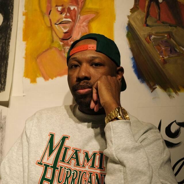 music icon with a backward snapback and oversized sweatshirt