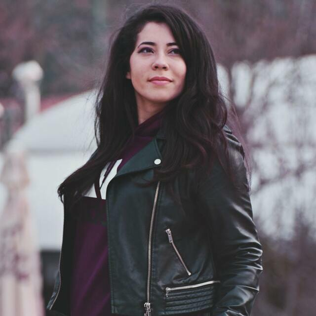 woman wearing black biker jacket with black jeans