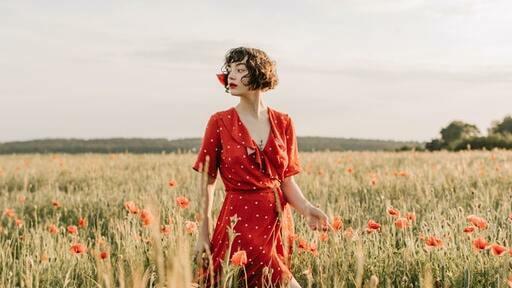 woman wearing a red blouson dress