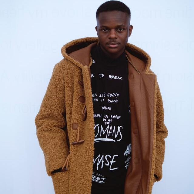 man wearing a brown suede jacket