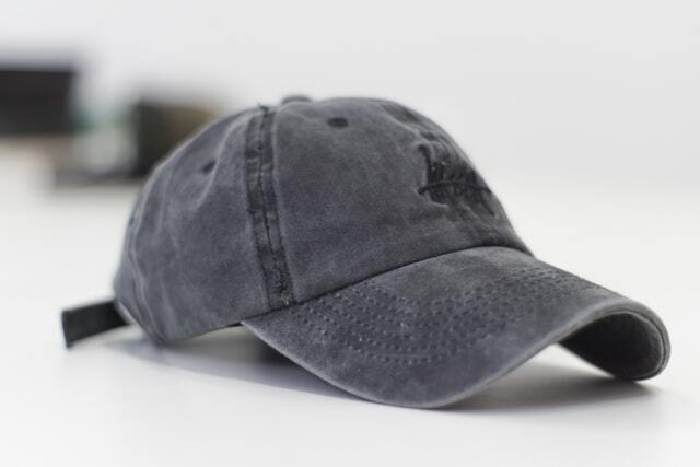 a grey baseball cap