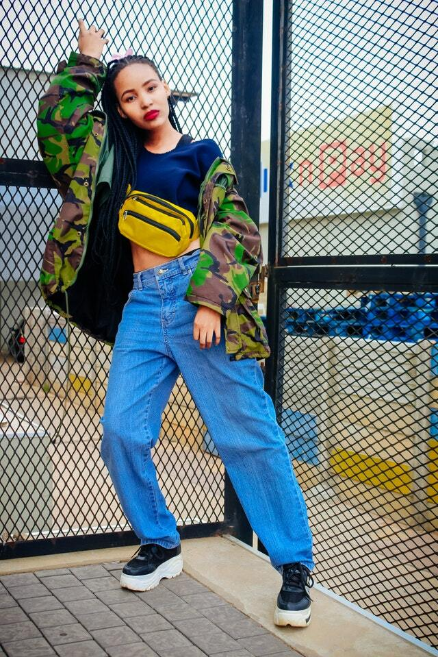 woman wearing boyfriend jeans with jacket