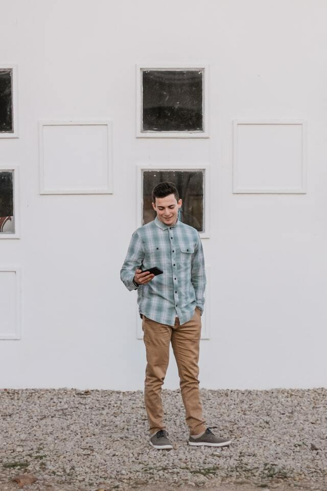 man wearing nerd style outfit with a plaid shirt