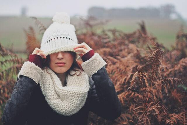 girl wearing a white beanie and scarf
